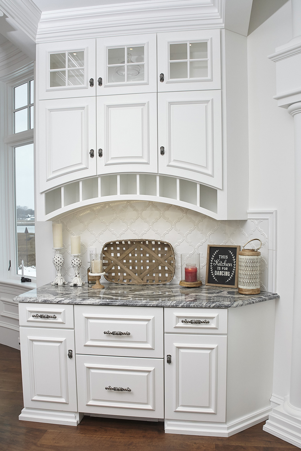 White Kitchen with Wine Rack and Arch Cabinet Doors